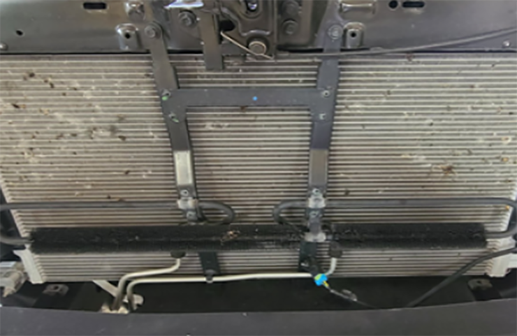 Enfriador de aceite de transmisión auxiliar eliminado